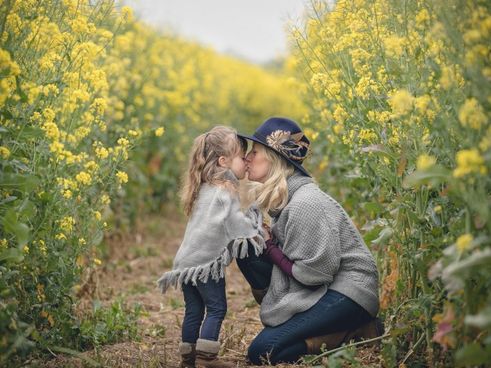 Family portrait rapeseed blossom field
