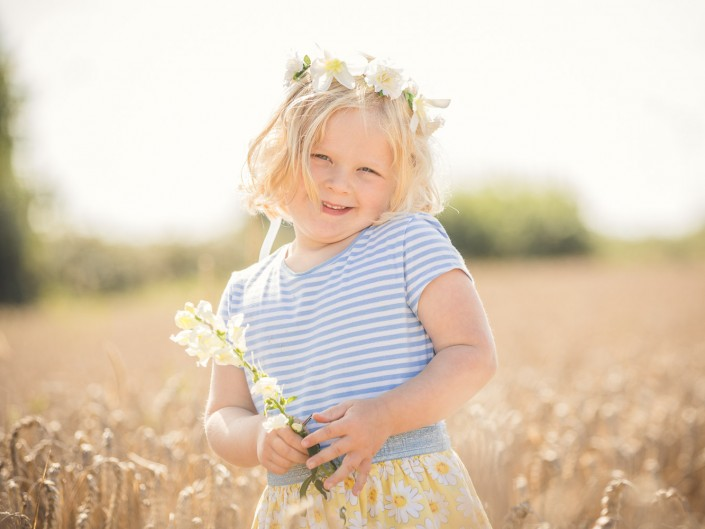child flower crown wheat field
