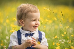 Toddler playing in field of buttercups, Gloucestershire photography