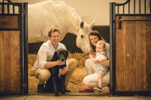 Family in the stable with grey horse, Gloucestershire Photographer