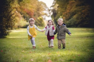 Children running autumn child portrait Gloucestershire