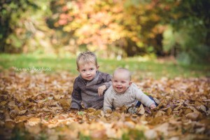Sibling child photography autumn leaves Gloucestershire