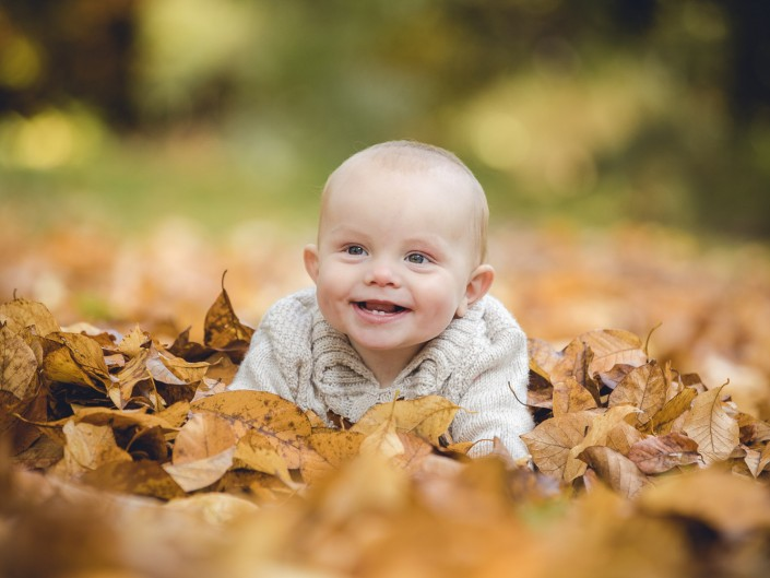 Child photographer Gloucestershire autumn leaves