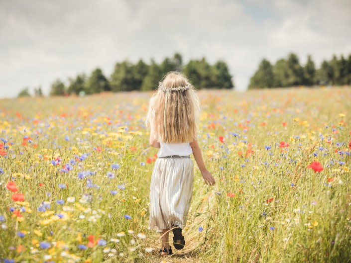Child walking wildflowers cotswold lavender