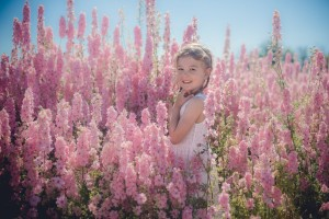Child portrait photography amongst delphiniums at Flower fields Worcestershire ©Hannah Buckland Photography