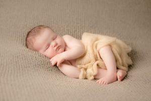 Newborn asleep wrapped up at Hannah Buckland Photography