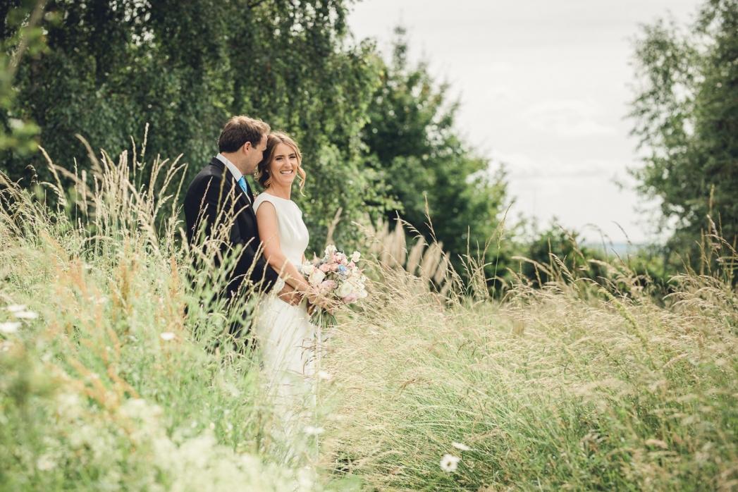 Bride groom wildflower meadow